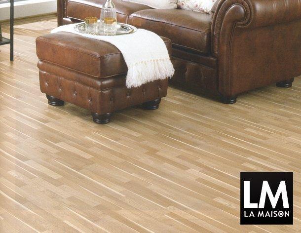 1-architettura-pavimento-laminato-pvc-color-legno-poltrona-pelle-invecchiata-marrone-610x472-1